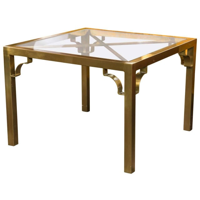 Square brass Mastercraft end table with X-detail under the glass and fretwork brackets.