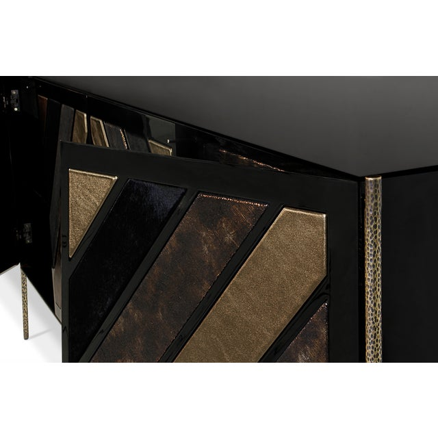 The geometric design and exotic finishes of the Opium cabinet will seduce you into a euphoric haze. Decadent, shimmering...