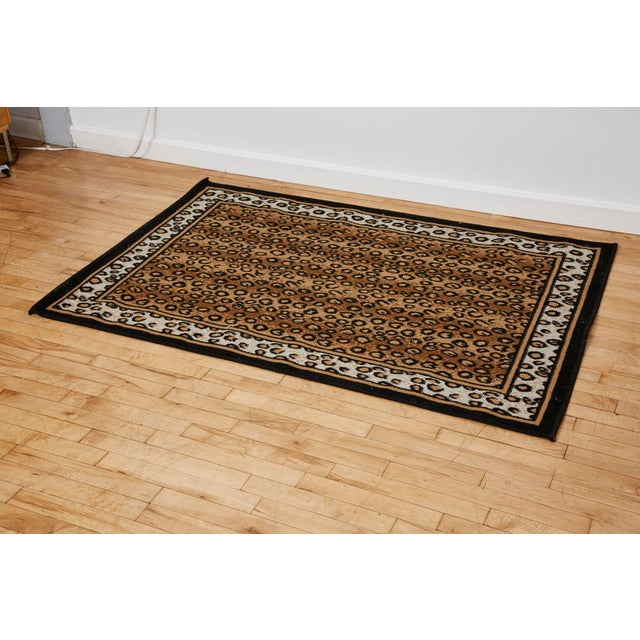 Very fun and glamorous accent rug with leopard print central area on brown background, accenting leopard print on white...