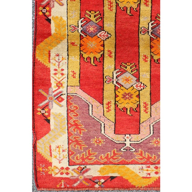 Produced in 1920s Turkey, this antique Oushak is characterized by a colorful and unique composition. This Turkish rug...