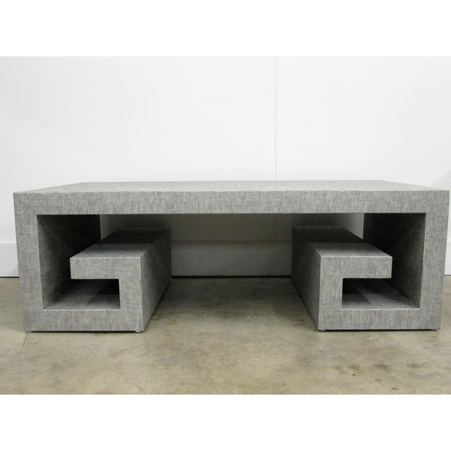 Maison Jansen inspired this generously sized, handcrafted coffee table created by a German artisan with double Greek key...