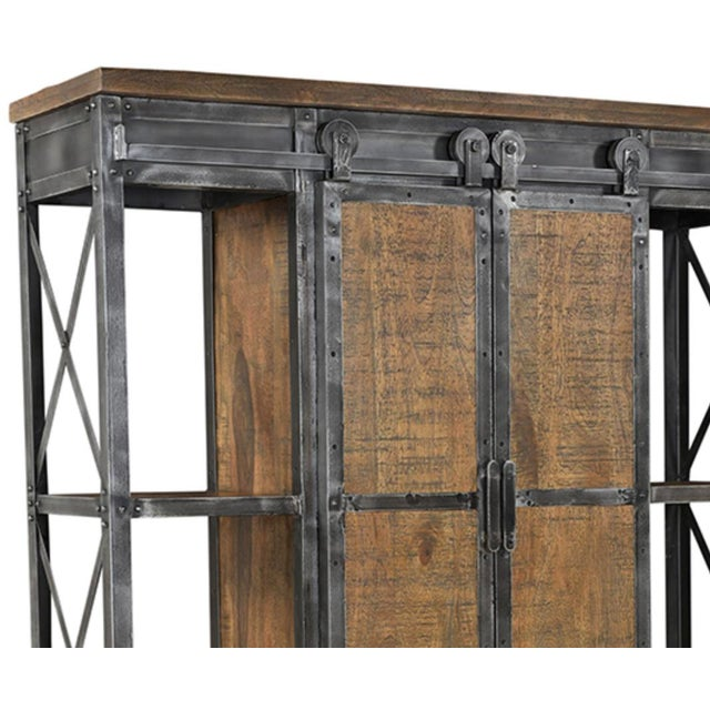 Reclaimed wood and gunmetal iron shelving unit/storage cabinet on casters with sliding door cabinet space in center. Each...