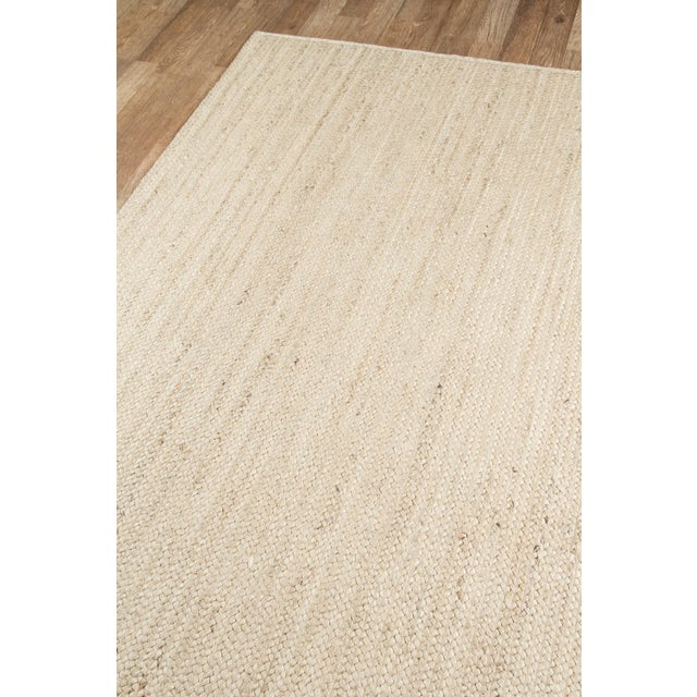 Organic materials serve as design inspiration for this decorative area rug collection with enduring style and strength....