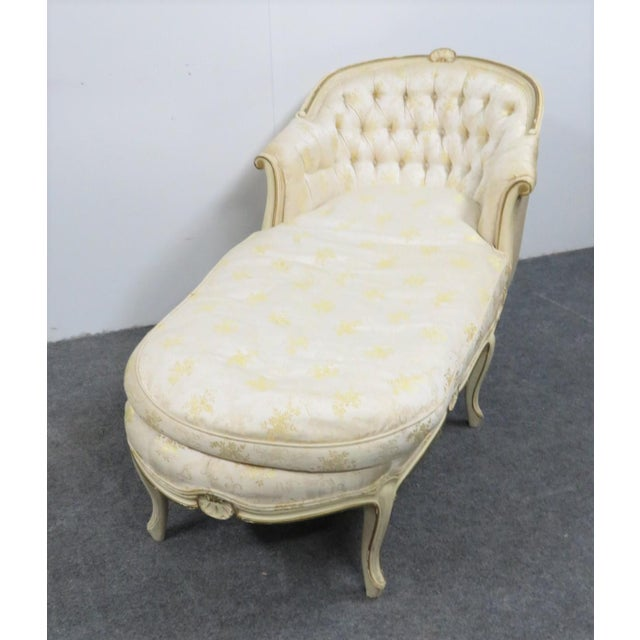 Cream painted with gilt highlights shell motif decoration. Cream and yellow floral upholstery with tufted back.