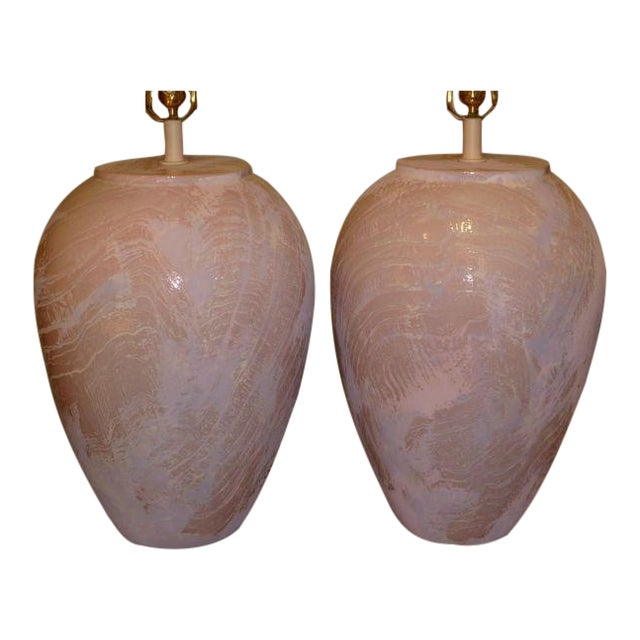 REDUCED FROM $1500...Large in form and uniqueness, this pair of oil jar form table lamps have a wonderful very textured...