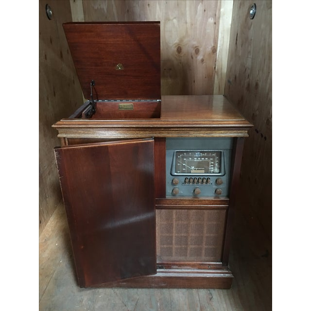 This lovely vintage hi-fi stereo cabinet comes complete with Radio & Record Player. How cool is that? Electrical is...