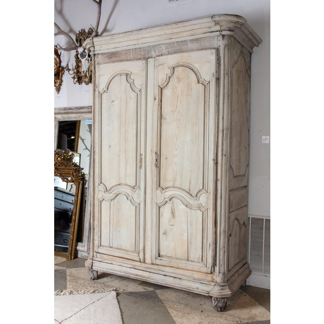 A large scale antique French oak armoire, this piece makes for quite a statement in a room and can accommodate a large...