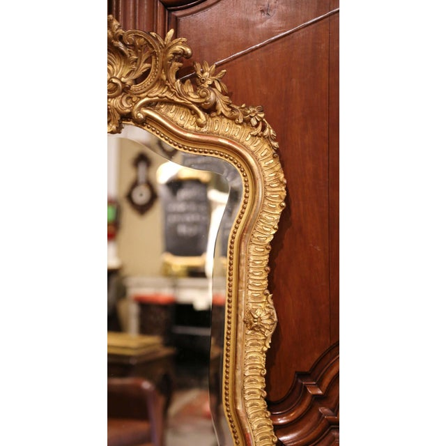 Late 19th Century 19th Century French Louis XV Carved Giltwood and Beveled Wall Mirror For Sale - Image 5 of 7