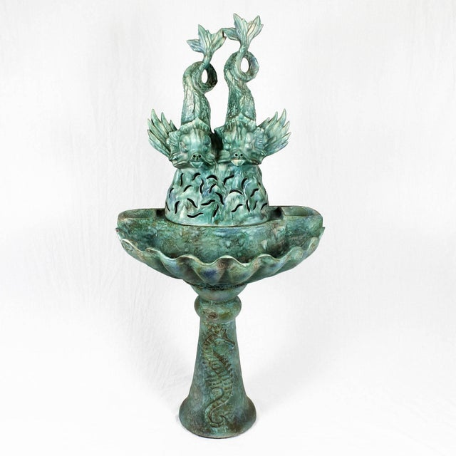 Green and blue enameled ceramic fountain, marine decoration. Form by three pieces, stand with seahorse decoration, basin...