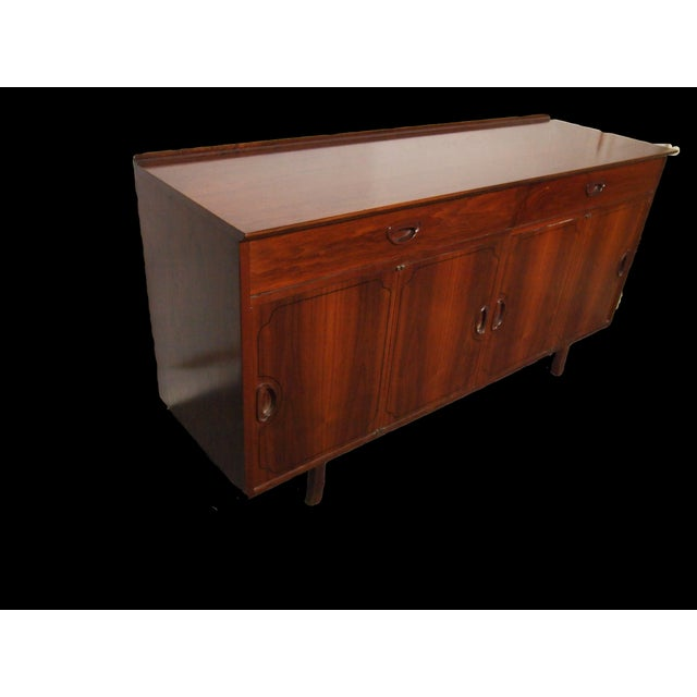 Mid-Century Danish credenza in solid rosewood, not veneered, with two slide-out drawers and three compartments behind...
