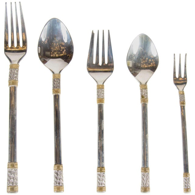This gorgeous set of Mid-Century Modernist silverware features an Aegean weave design in sterling silver with 24-karat...