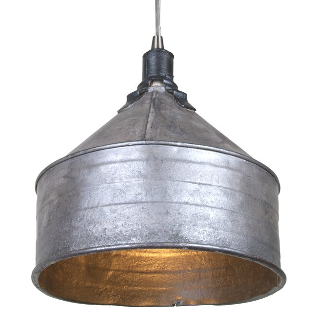 A vintage galvanized tractor funnel has been repurposed into a pendant light fixture by Salvatecture Studio. Refinished...
