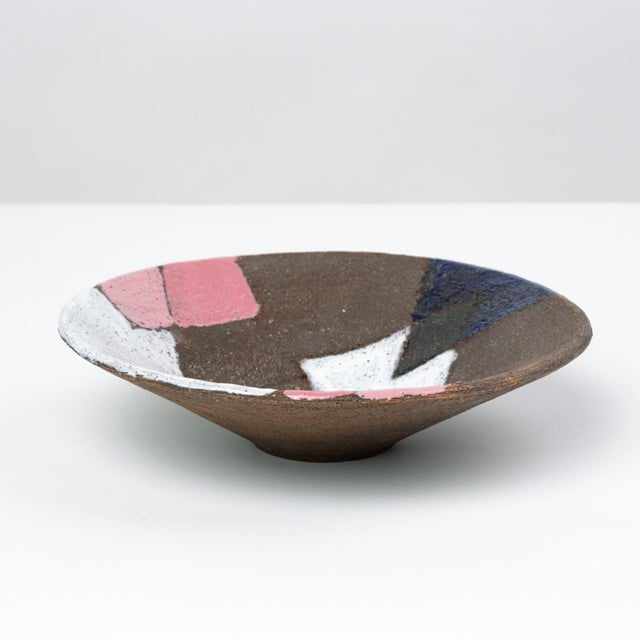 A decorative bowl with straight-slanted sides from Italian ceramicist Bitossi. Attributed to Aldo Londi, this patchwork...