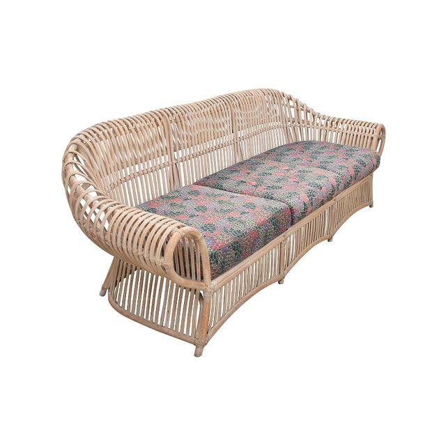 Mid Century bentwood bamboo three-seater sofa with cushioned seats. This sofa features a rounded bamboo back and arms...