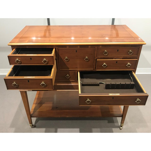 EJ Victor Chest with 7 drawers and open shelf on bottom. Each drawer has a silverware sleeve and compartments for...