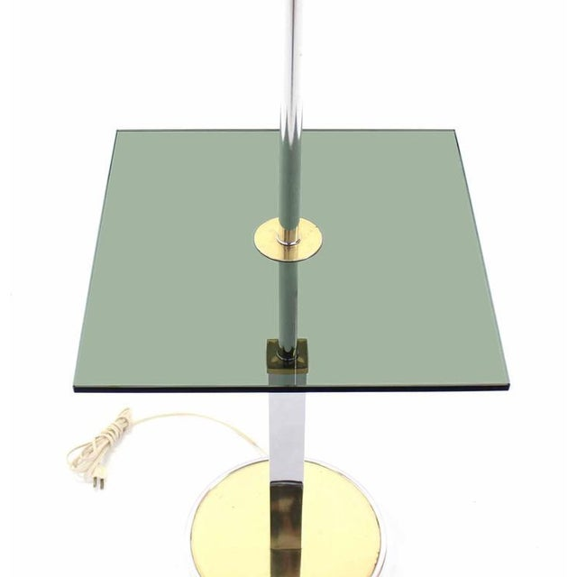 Very nice mid-century modern floor lamp side table with original faux leather shade.