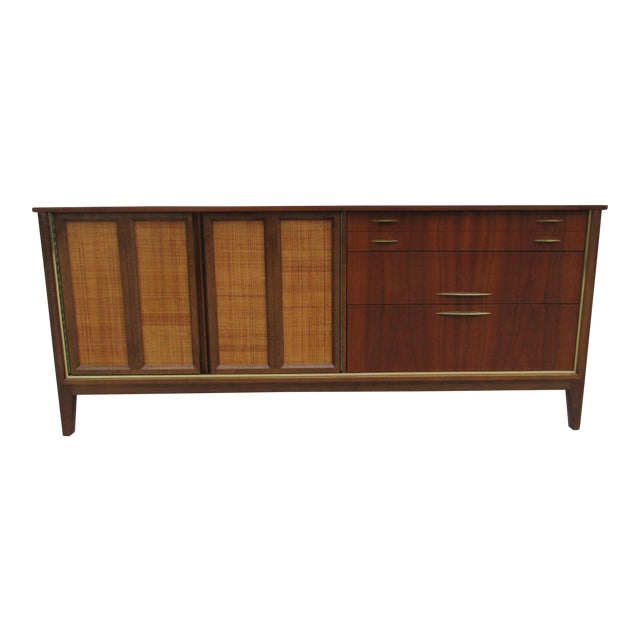 Mid Century Walnut Triple Dresser with Reversible Cane Side Panels For Sale