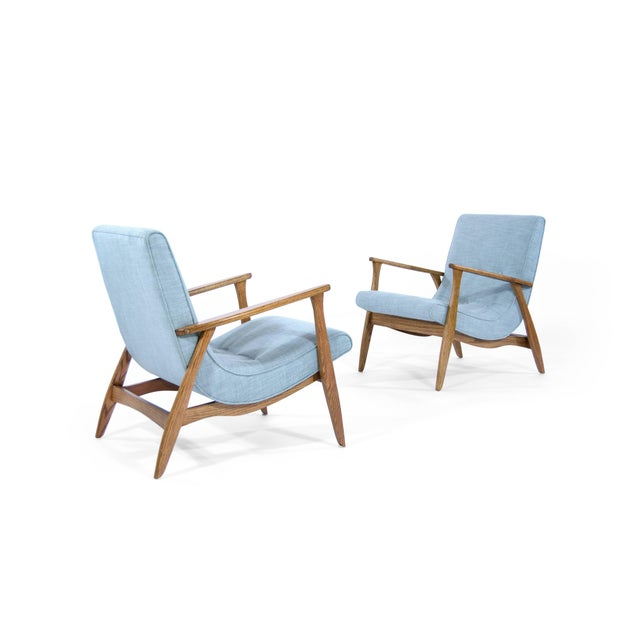 Stunning pair of lounge chairs, original from the 1960s. Oak frames fully restored and in mint condition. Newly...