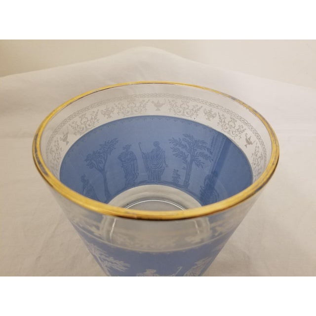 Lovely soft Wedgewood Blue background with a white Roman Grecian scene surrounding the ice bucket. Rimmed in gold, this...