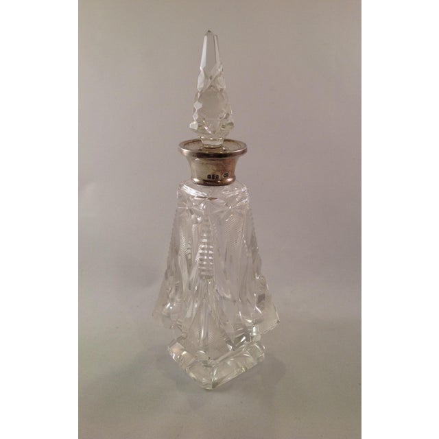 Offered is a victorian pyramid shape faceted cut crystal perfume bottle with original stopper and sterling silver collar....