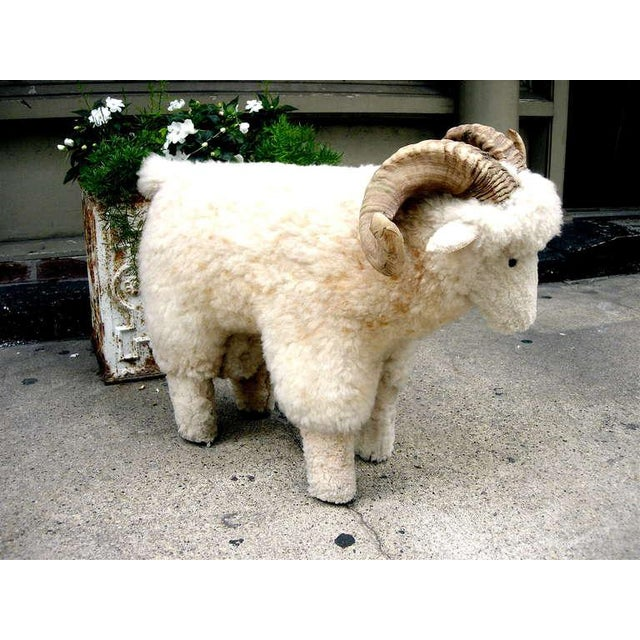 Charming sheep skin covered sheep foot stool with real horn. In the style of francois xavier lalanne 1970