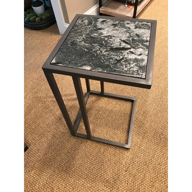 Black Fossil marble top on Burnished Riviera metal base. By Alder & Tweed