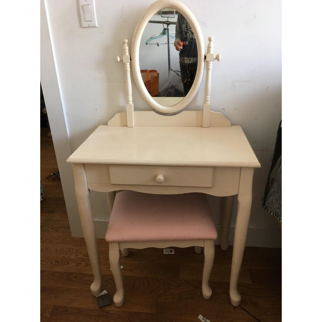 The vanity is in good condition. It has a pink fabric colored seat. Has some minor scratches with use. It measures about...