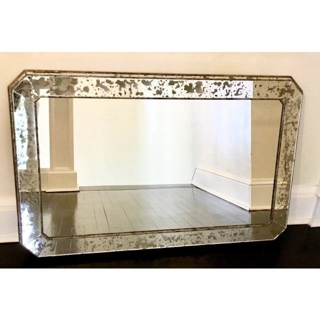 Stunning, sleek Art Deco mirror in silver leaf with custom eglomisé glass. Very well constructed and substantial. Solid...
