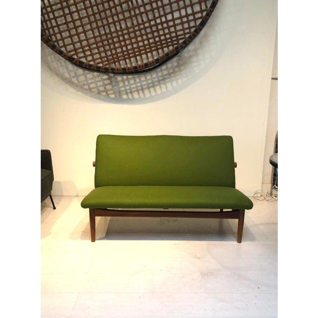 "Teak ""Japan"" series 2-seater sofa by Danish designer Finn Juhl, designed in 1957 under license from France & Son and made..."