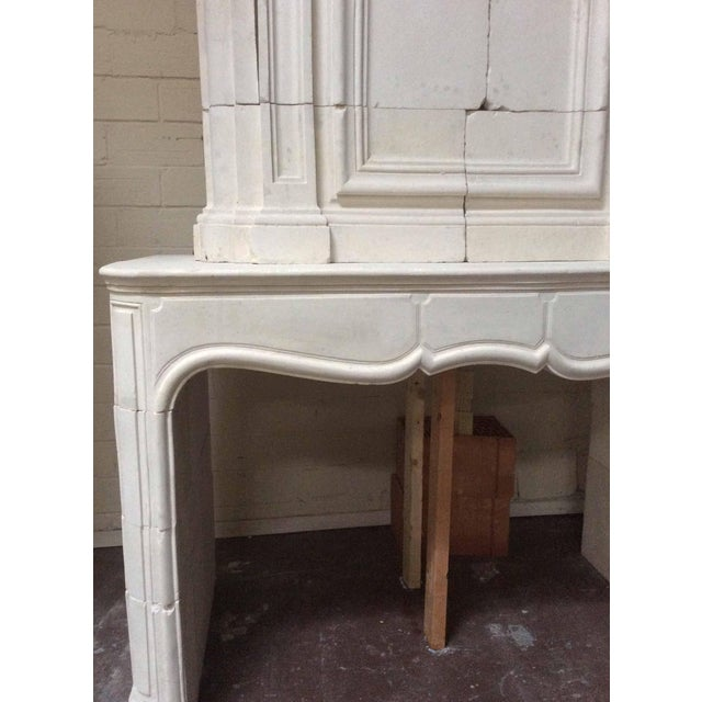 This European fireplace features a masterfully carved Trumeau and legs with a scalloped designed mantel. A wonderful piece...