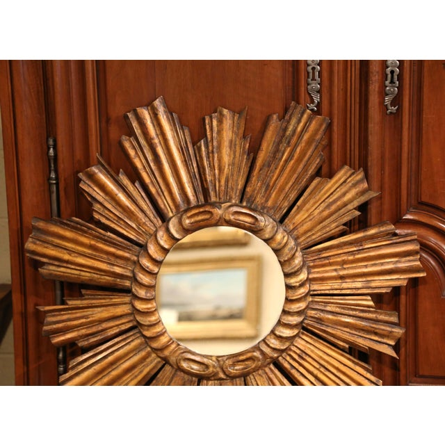 Create a focal point in any room with this gleaming, important sun mirror. Hand carved in France, circa 1920, the large,...