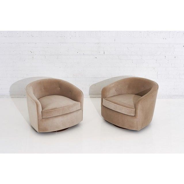 Milo Baughman pair swivel chairs on walnut bases, circa 1960. New velvet upholstery.