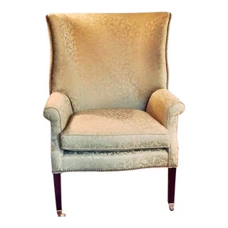 Henredon Wingback Chair With Brass Tacking and Brass Wheel Front Legs For Sale