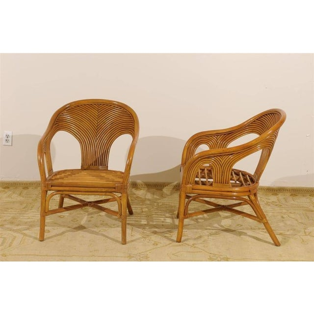 A beautiful set of six vintage bamboo armchairs, circa 1970. Expertly made pieces with fabulous detail. Excellent restored...
