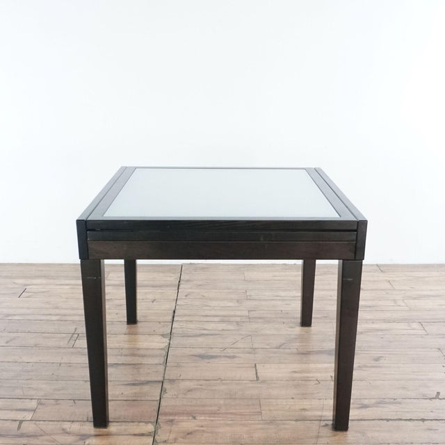 Glass insert expandable wood table and 4 wood chairs. Brand is Design Within Reach. Dimensions (in): 36.0 W x 36.0 D x...