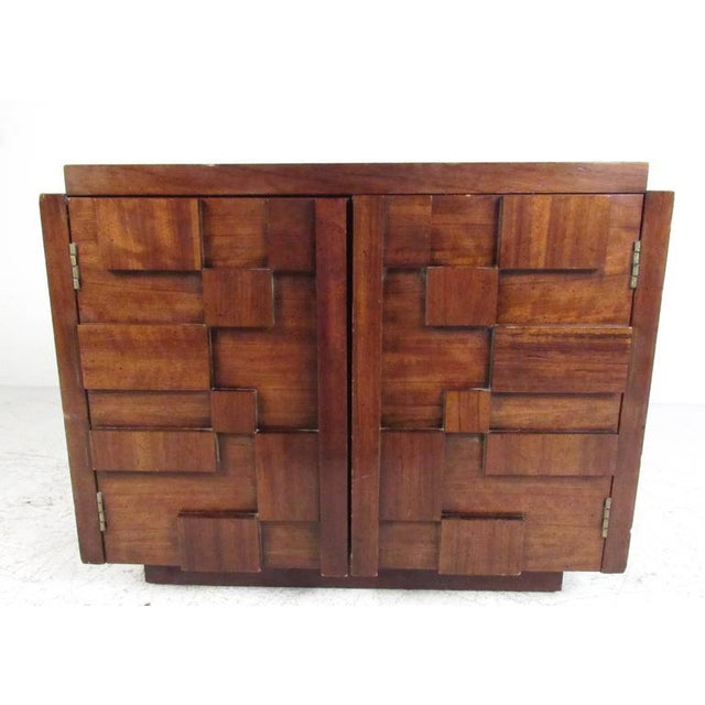 This matching three-piece bedroom set by Lane Furniture includes sculptural front armoire dresser, single bedside...