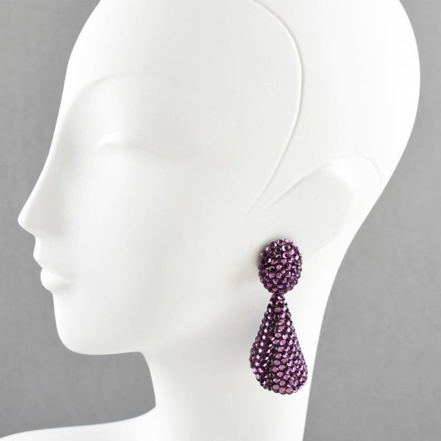 Gorgeous statement clip-on earrings designed by Richard Kerr in the 1980s. They are made up of his signature pave...
