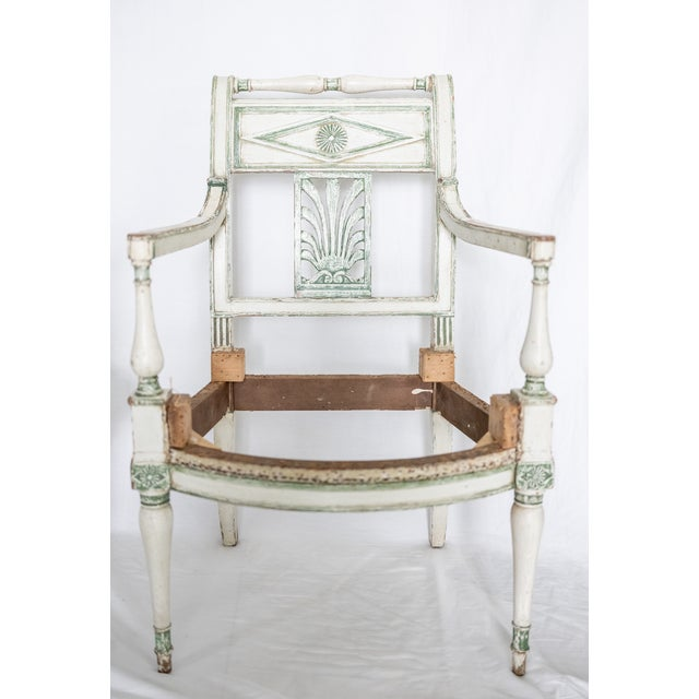 A pair of French Empire Painted Fauteuils from 19th century France. It has been restored to excellent condition.
