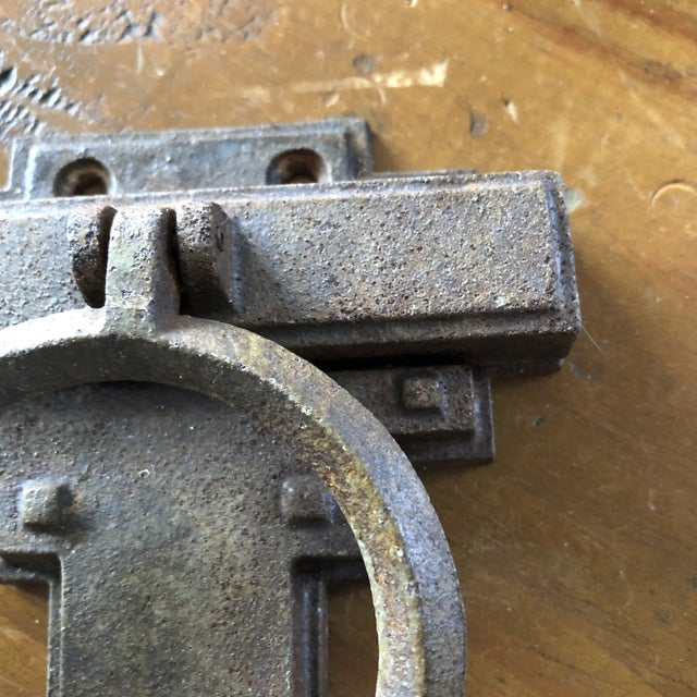 Rustic metal door knocker with Art Deco geometric details. Adds age and elegance for quick curb appeal.