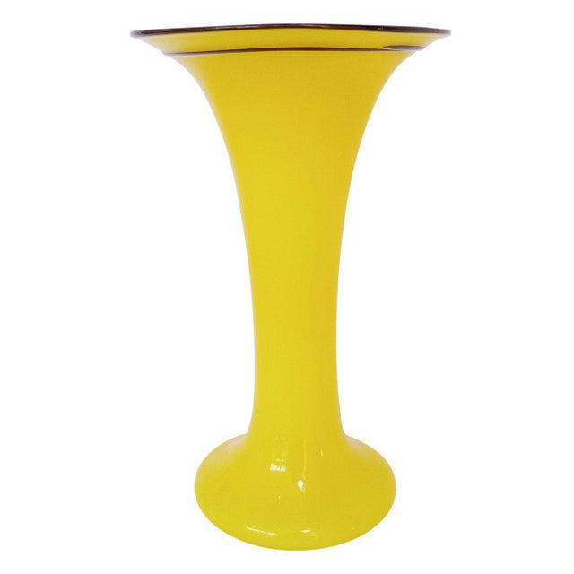 """Bright yellow mouth-blown """"Tango"""" glass vase with black accents and white interior. """"Tango"""" glass inspired by Argentine..."""