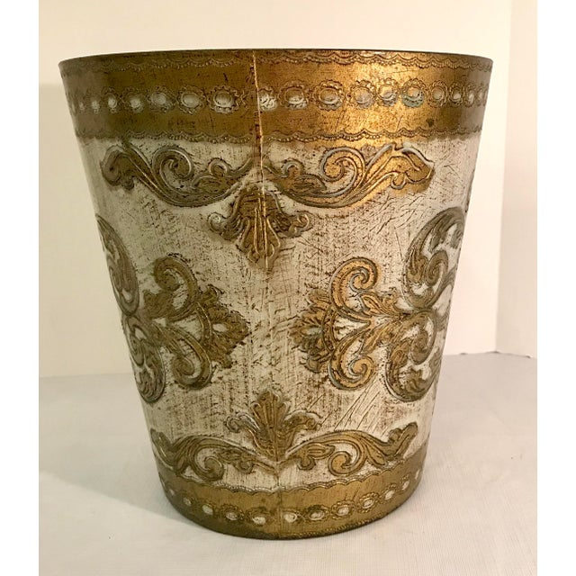 Nice faux wood Italian Florentine gold and ivory Trash can. Embossed Italy on bottom. Made in the mid 20th century.