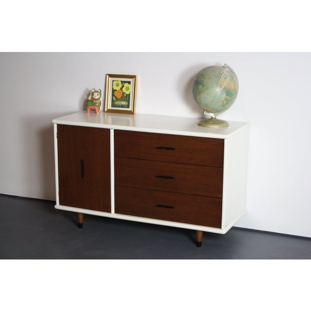 About the 2 Tone Mid Century Modern Console This 3 drawer / Single Door 2 toned console is the perfect blend of white and...