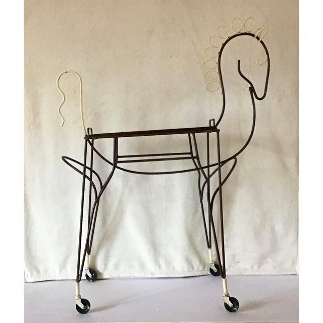 Mid-century modern original 1950's Frederick Weinberg horse silhouette rolling bar cart, original white paint on mane,...