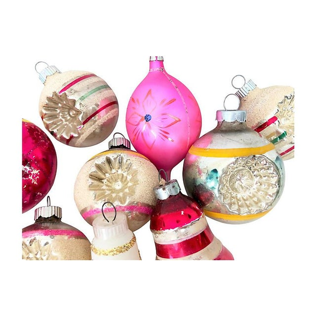 Colorful rare set of 17 vintage hand-decorated glass Christmas ornaments, in assorted shapes and sizes.