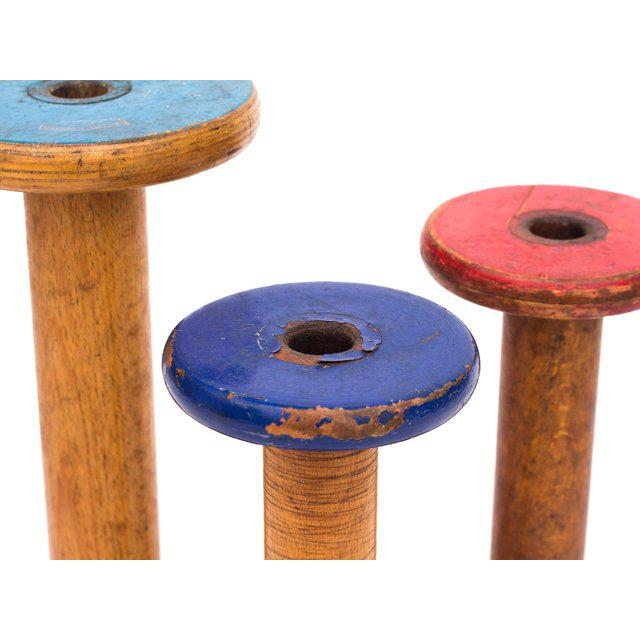 """A set of 3 antique Canadian wooden textile spools from the early 1900s. The spools are marked, """"Roberts & Hirst Ltd...."""