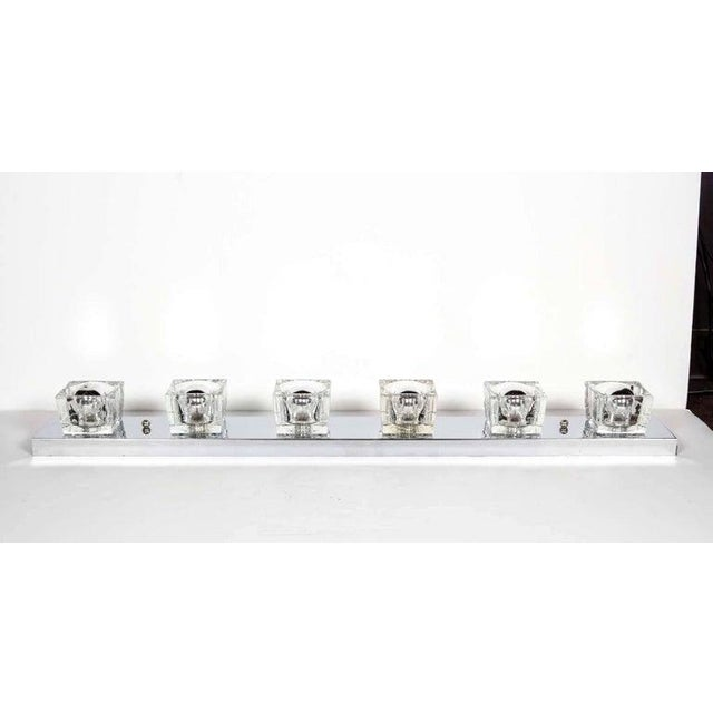 Mid-Century Modern sconce featuring six handcut-glass block shades. Streamline frame in polished chrome with cubist design...