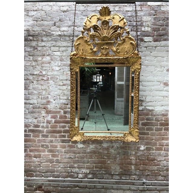 Louis XIV, carved gilt wood mirror, Provenance private collection France This Louis XIV mirror is exuberant, symmetrical...