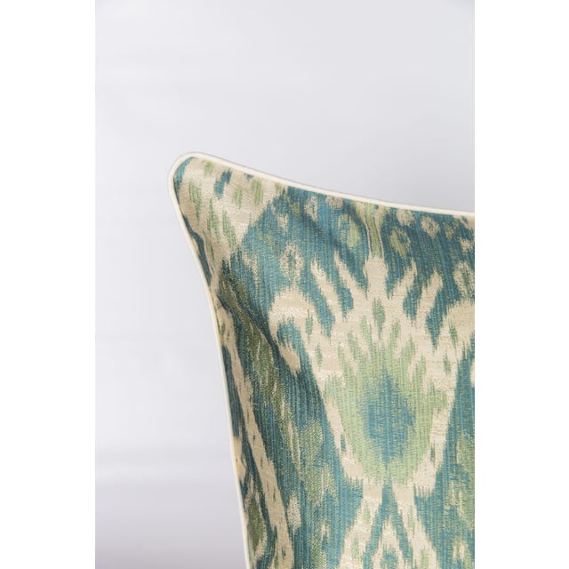 Pair of custom green, teal and cream ikat pattern pillows. Patterns on fronts, solid coordinating ivory backs and cording....