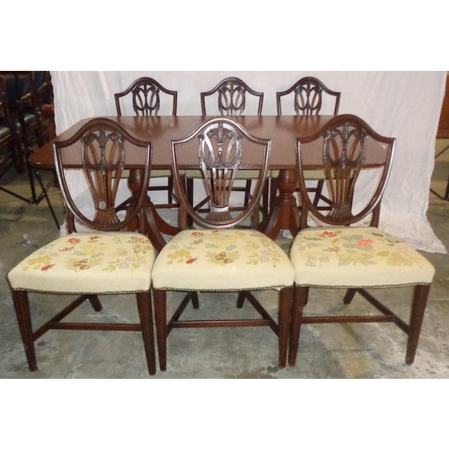 Wonderful Duncan Phyfe mahogany dining table and 6 chairs with needlepoint seats. This set is in fantastic shape and will...