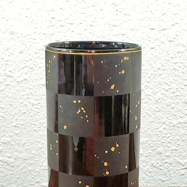 A striking, black-on-black cylinder vase designed by Elsa Fischer-Treyden (form) and Frogen Yang (decoration) for...